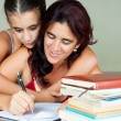 Latin mother and daughter studying — Stockfoto