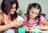 Mother and daughter making origami — Stock Photo