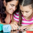 Mother and daughter making origami — Stock Photo #12116442