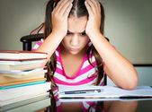 Angry and tired schoolgirl studying — Stockfoto
