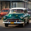 Several old american cars in Havana - Stock Photo