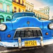 Stock Photo: Old americcar in colorful neighborhood in Havana