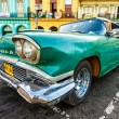 Classic Cadillac in a colorful neighborhood in Havana — Stock Photo #12316196