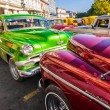 Group of classic vintage cars parked in Old Havana — Stock Photo #12316203