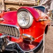 Shiny vintage Chevrolet in front of The Great Theater of Havana — Stock Photo