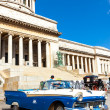 Vintage Ford parked in front of the Capitol in Havana — Stock Photo