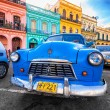 Vintage Dodge (old car) parked in a colorful neighborhood in Havana — Stock Photo