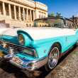 Stock Photo: Classic Ford Fairlane in front of Capitol of Havana