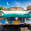 Classic Ford Fairlane in front of the Capitol of Havana — Stock Photo #12345697