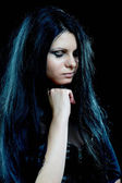 Beautiful goth woman with long hair — Stock Photo