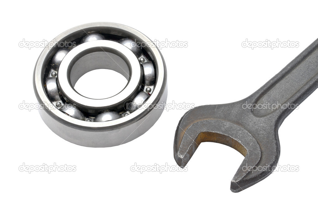 Ball bearing and Wrench isolated on white — Stock Photo #11444826