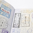 Immigration stamps on passport — Stock Photo #11602888