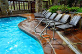 Swimming Pool and Deck Chairs — Stock Photo