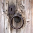 Old rusty metal door handle and keyhole — Stock Photo #11095706