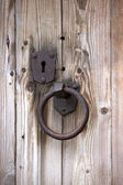 Old rusty metal door handle and keyhole — Stock Photo