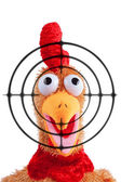 Shouting rooster toy with target on foreground — Stock Photo