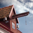 Lifting construction on old house roof — Stock Photo