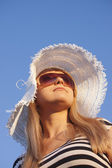 Young smiling blond woman with white hat — Stock Photo