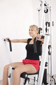 Young blond woman workout in gym — Stock Photo