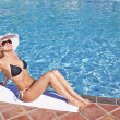 Young blond woman at swimming pool — Stock Photo