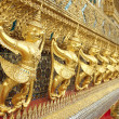 Royalty-Free Stock Photo: Row of golden Tosakanth statues