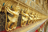 Row of golden Tosakanth statues — Stock Photo