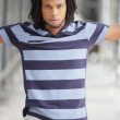 Man posing in a striped shirt — Stock Photo