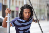 Male model posing by scaffolding — Stock Photo