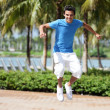 Young male jumping in the park — Stock Photo