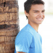 Young male by the tree — Stock Photo