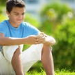 Young male with a mobile in park — Stock Photo #11585344