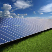 Solar panels on the grass — Stock Photo
