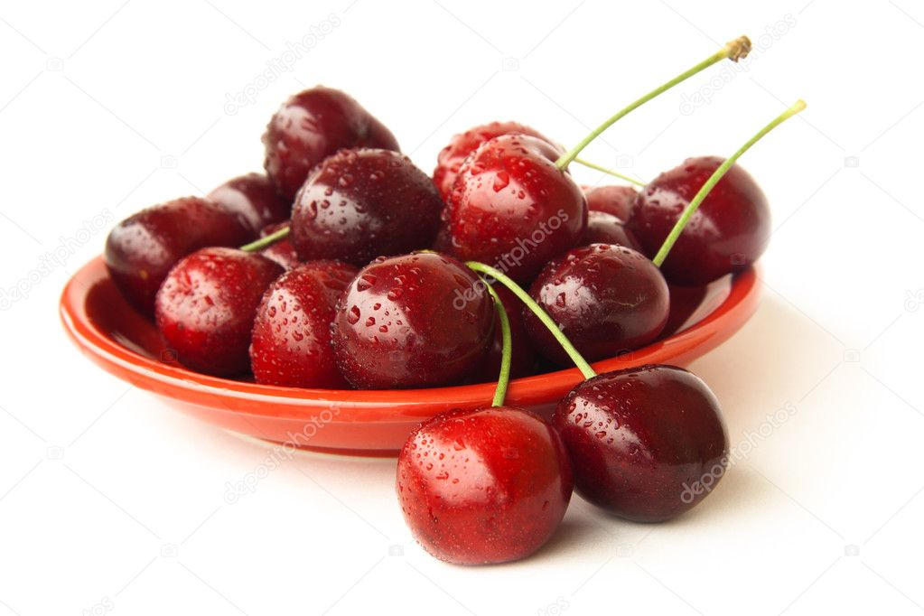 Fresh cherries on a red plate isolated over white background  Stock Photo #10942610