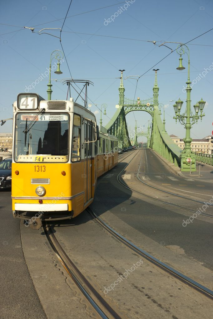 Tram coming from Freedom bridge, Budapest, Hungary — Stock Photo #10951279