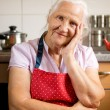 Elderly woman in the kitchen — Stock Photo