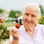 Elderly woman on a terrace — Stock Photo #12333620