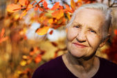 Autumn elderly woman — Stock Photo