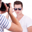 Model posing for a professional photographer — Stock Photo
