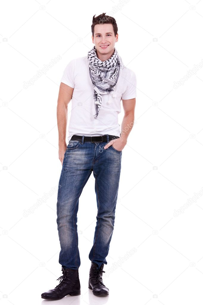 Young casual man wearing boots, jeans and scarf looking at the camera on white background — Stock Photo #10797017