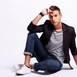 Seated fashion male model — Stock Photo