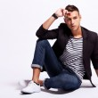 Fashionable young casual man sitting — Stock Photo