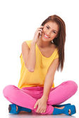 Casual woman is sitting and talking on mobile phone — Stock Photo