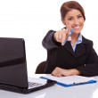Businesswoman at desk pointing — Stock Photo