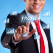 Business man hand pressing profit button — Stock Photo #11068843