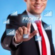 Stock Photo: Business man hand pressing profit button