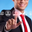 Business man pressing round social buttons - Stock Photo