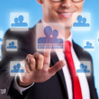 Business man pressing a social network button — Stock Photo #11068859