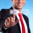 Foto Stock: Business man pushing On button