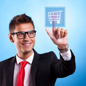 Business man pressing a shopping button — Stock Photo