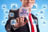 Business man pressing a social network button — Stock Photo